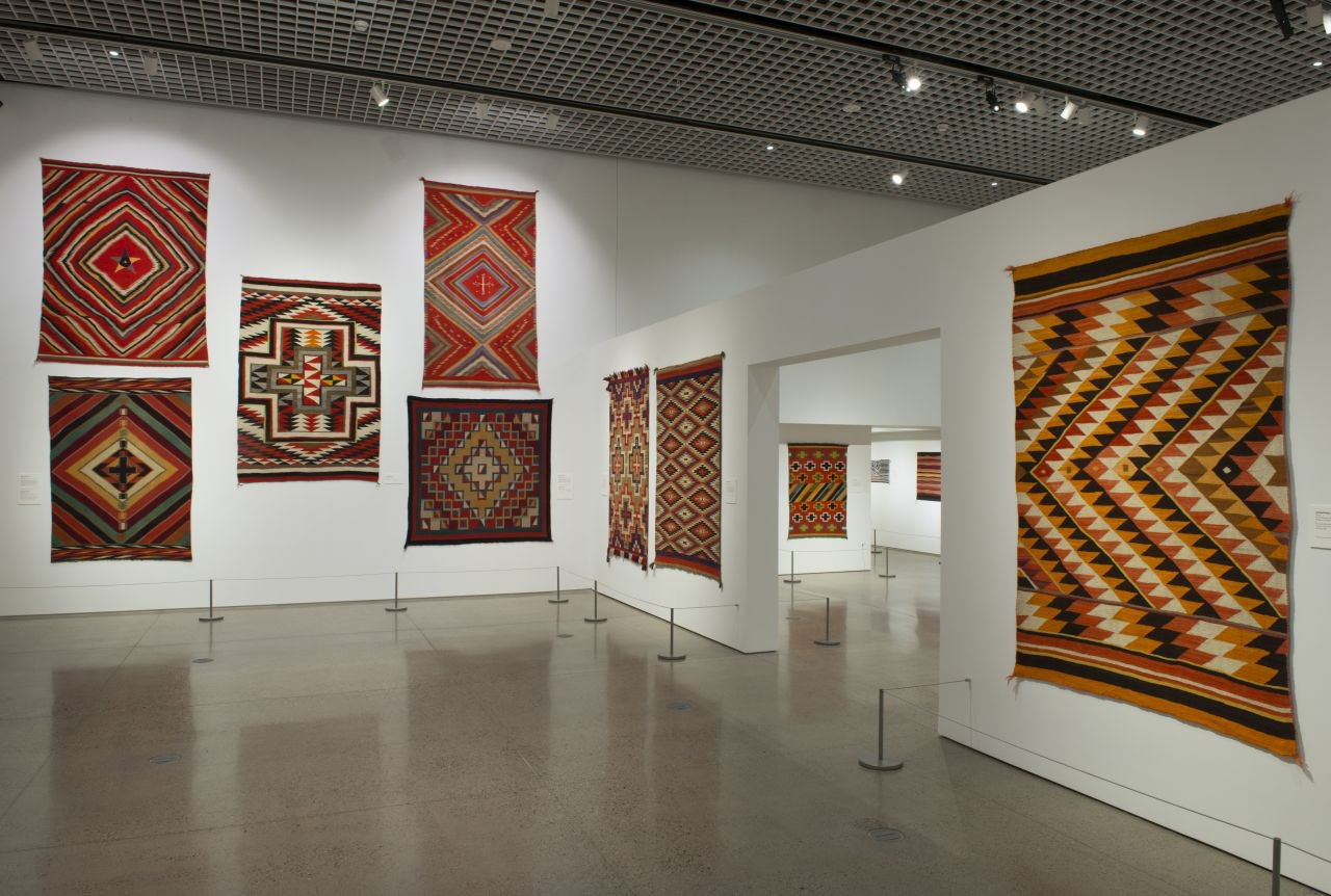 exhibition gallery with Native American textiles