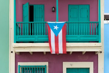 colorfully painted balcony with Puerto Rican flag