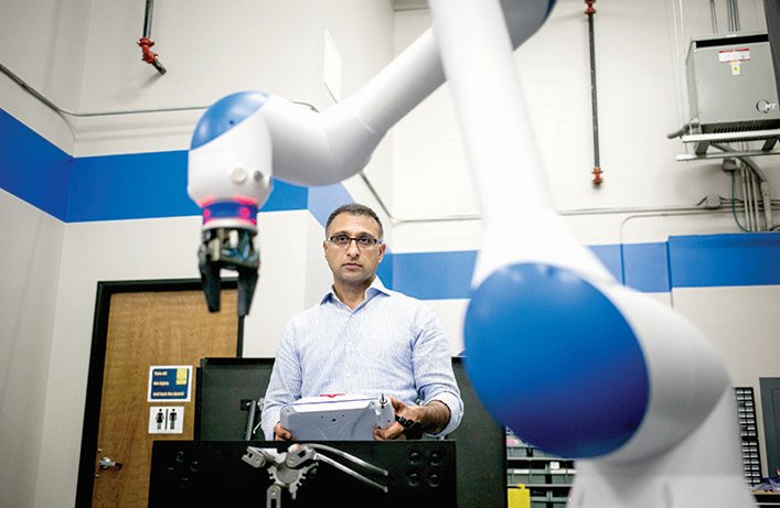 Research scientist operating a robot