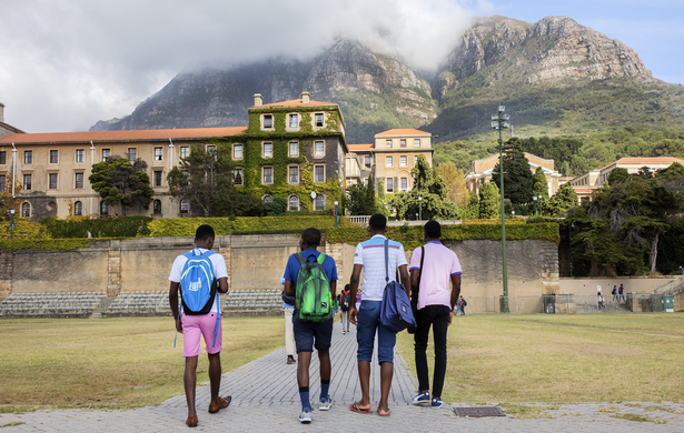 campus landscape with students in foreground and mountains in background