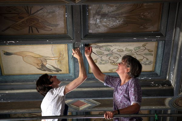 [art conservators working on a ceiling fresco]