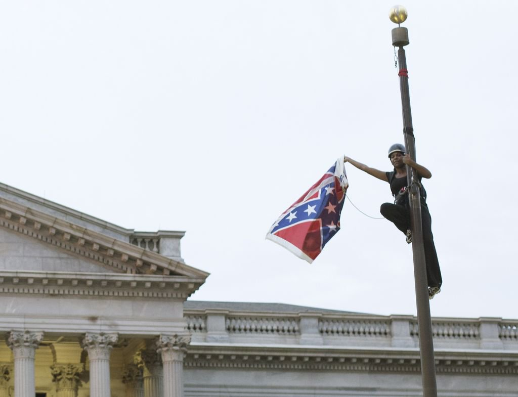 Bree Newsome scales confederate flag pole