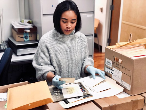 library science student processing archival records