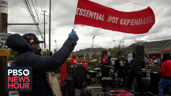 "rally with banner that reads ""essential not expendable"""