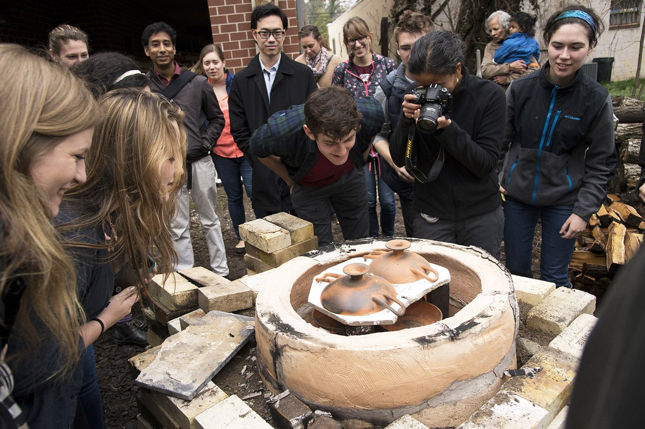 students in front of pottery kiln