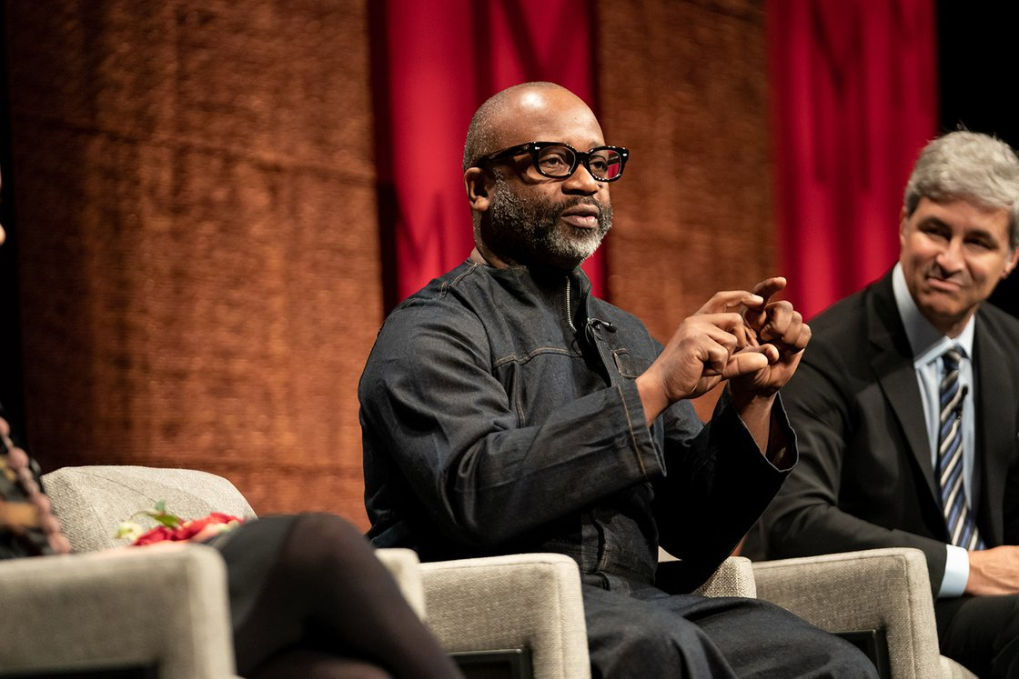 Artist Theaster Gates on stage with panelists